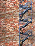 Fire escape on old brick wall Stock Image