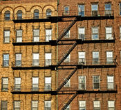 Fire escape on old building. Exterior of old tenement building with metal staircase, Boston, Massachusetts, U.S.A Royalty Free Stock Image