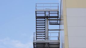Fire escape outdoor architecture ladder steps emergency. Rescue stock footage