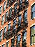 Fire escape, SoHo, New York City. Fire escape on a brick building in the SoHo-Cast Iron Historic District, New York City Stock Images