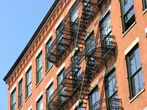 Fire escape, SoHo, New York City. A red brick building in the SoHo-Cast Iron Historic District, New York City Stock Images