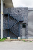 Fire escape staircase on the brick wall. Of a building Stock Photo