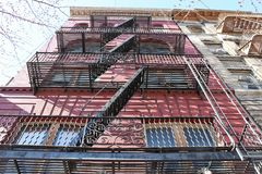 Fire escape stairs and balconies on the outside of a building in New York royalty free stock photos