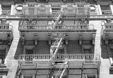 Fire escape and stairs on exterior of walk up apartment building Royalty Free Stock Photos