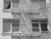 Fire escape and stairs on exterior of walk up apartment building Stock Photos
