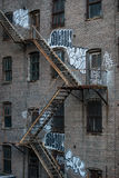 Fire escape stairs on an old building exterior in New York, Manhattan Royalty Free Stock Photography