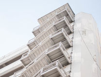 The fire escape stairs on white building stock photo