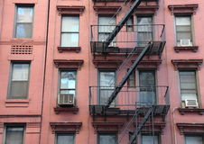 Fire Escape Steel Ladder on Urban Red House Facade Stock Images