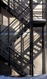 Fire escape to the wall. Black iron fire escape to the wall of a residential building Royalty Free Stock Photography