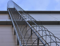 Fire Escape on the wall of high-rise buildings. View from below, close-up Royalty Free Stock Image