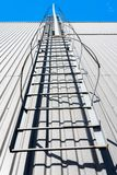 Fire escape in a new modern building. Fire escape on the wall of an industrial building royalty free stock photo