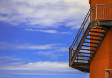 Fire escape on the wall of lighthouse Stock Photo