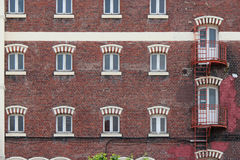 A fire escape was installed along the facade of a brick-built building in Lille (France). A fire escape was installed along the facade of a brick-built building royalty free stock images