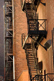 Fire Escapes and Bricks Stock Image