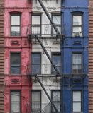 Fire escapes of a colorful building in New York City royalty free stock image