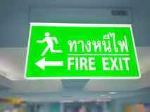 Fire exit sign, Emergency exit sign, Inside a building. Stock Image