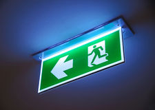 Fire exit ,green emergency exit sign. Royalty Free Stock Photography
