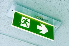 Fire exit ,green emergency exit sign stock image