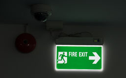 Fire exit guide post on the black background Royalty Free Stock Photography