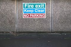 Fire exit keep clear no parking sign royalty free stock photography