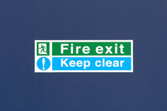 Fire Exit - Keep Clear sign on door Stock Image