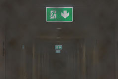 Fire Exit Light in Smoky Corridor of Apartment Stock Photography