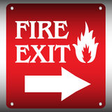 Fire exit plate. Metallic plate with fire symbol, arrow showing to right, and the text fire exit written with capital letters Royalty Free Stock Photography