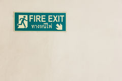 Fire Exit plate. Glow in the dark on old wall Stock Images