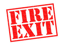 FIRE EXIT. Red Rubber Stamp over a white background Stock Images