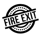 Fire Exit rubber stamp. Grunge design with dust scratches. Effects can be easily removed for a clean, crisp look. Color is easily changed Stock Images