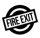 Fire Exit rubber stamp. Grunge design with dust scratches. Effects can be easily removed for a clean, crisp look. Color is easily changed Royalty Free Stock Photography