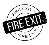 Fire Exit rubber stamp. Grunge design with dust scratches. Effects can be easily removed for a clean, crisp look. Color is easily changed Royalty Free Stock Photo