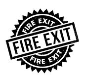 Fire Exit rubber stamp. Grunge design with dust scratches. Effects can be easily removed for a clean, crisp look. Color is easily changed Royalty Free Stock Images