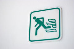 Fire exit sign. On white wall Royalty Free Stock Image