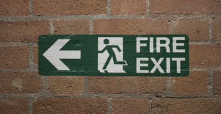 Fire Exit sign on bricks Stock Image