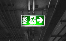 Fire exit sign in car park building Stock Image