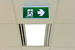 Fire exit sign on ceiling with light Stock Photography