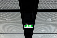 Fire exit sign on ceiling Stock Photos
