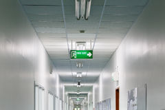Fire exit sign in factory Royalty Free Stock Photography