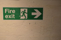 Fire Exit sign. Modern fire exit sign attached to a wall Royalty Free Stock Photos