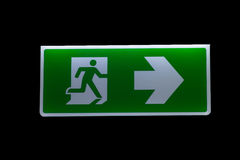Fire Exit Signs. Fire exit sign on a black background Royalty Free Stock Images