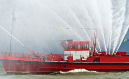 Fire extinguish boat on duty Stock Photos
