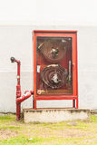 Fire extinguish equipment. Hydrant with water hoses and fire extinguish equipment Stock Photos