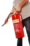Fire extinguisher. Man using foam fire extinguisher stock photography