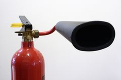 Fire extinguisher. A red isolated fire extinguisher Stock Image