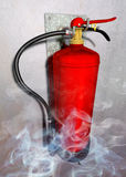 Fire extinguisher. Illustration of a fire extinguisher in rising smoke fitted at a gray wall Stock Photography