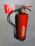 Fire extinguisher. Illustration of a fire extinguisher in red fitted at a gray wall Stock Photo