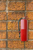 Fire extinguisher on brick wall, Fire proof system, Fire protect Stock Image