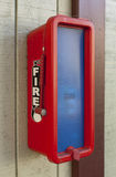 Fire extinguisher. Bright red and blue plastic fire extinguisher box Stock Photography