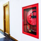 Fire extinguisher in the building stock image